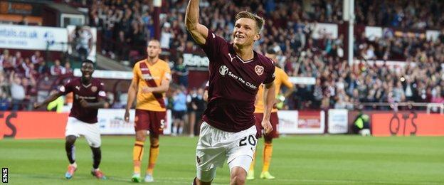 Gavin Reilly celebrates scoring for Hearts