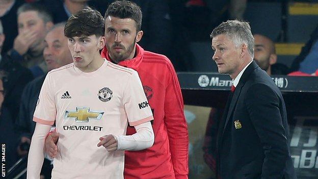 Ole Gunner Solskjaer speaks to James Garner as he prepares to make his senior Manchester United debut