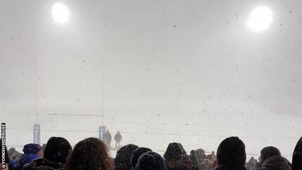 Snow continued to fall heavily during the course of the game, leading to postponement