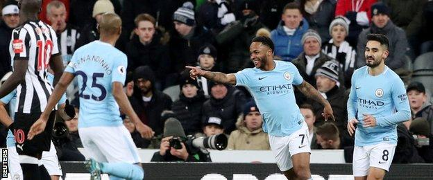 Raheem Sterling celebrates Manchester City's opener