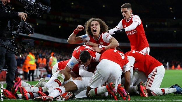 Arsenal players celebrate a goal against Newcastle on Sunday
