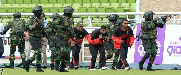 The Bangladesh Army performs a drill to evacuate players