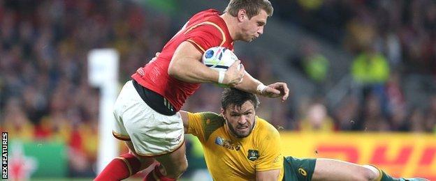 Adam Ashley-Coooper tackles Wales fly-half Dan Biggar