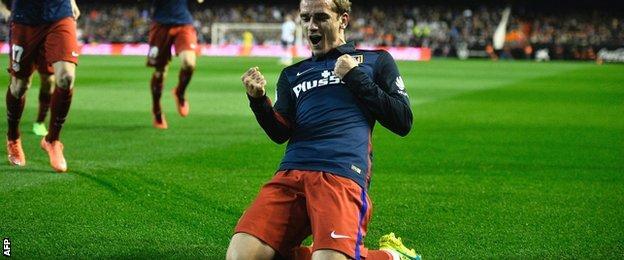Antoine Greizmann of Atletico Madrid celebrates scoring against Valencia
