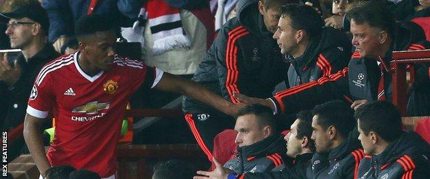 Anthony Martial shakes hands with Louis van Gaal