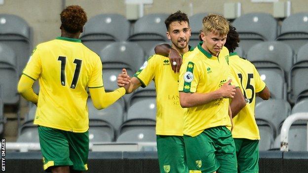 Adam Phillips celebrates scoring a penalty for Norwich City in Premier League 2