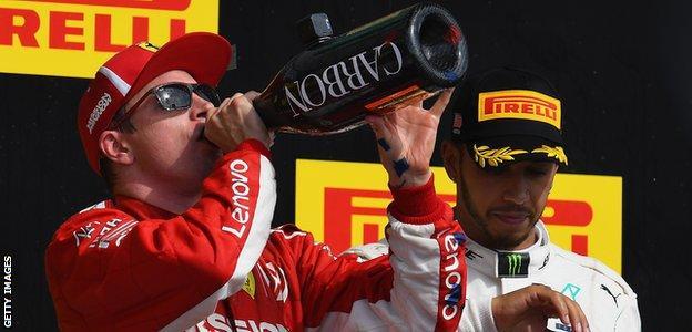 Kimi Raikkonen and Lewis Hamilton on the podium at the United States Grand Prix
