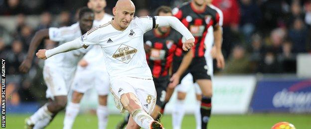 Jonjo Shelvesy scores from the penalty spot for Swansea