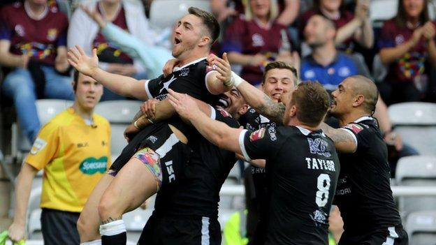 Curtis Naughton celebrates Hull's second try at St James' Park