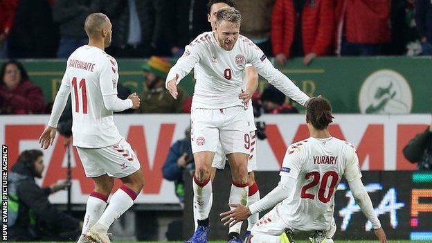 Denmark players celebrate Jorgensen's goal
