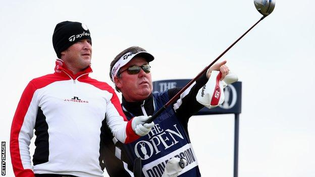 Jamie Donaldson and caddie Michael Donaghy discuss their options from the sixth tee
