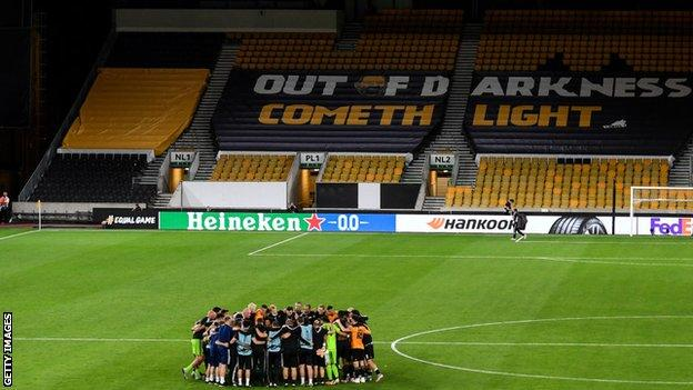 Wolves players and officials celebrate beating Olympiakos