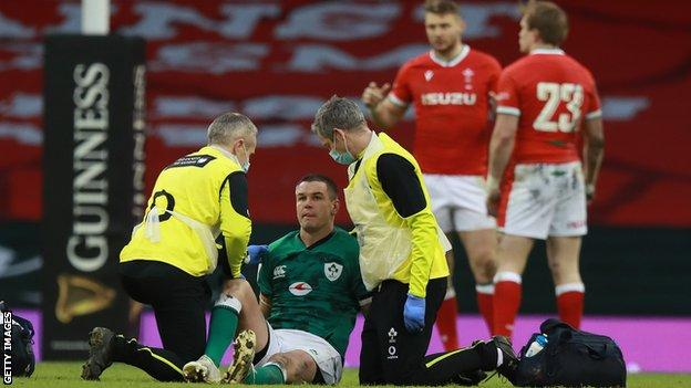 Ireland's Johnny Sexton is attended to by physios
