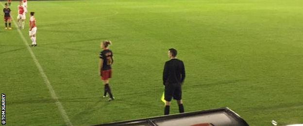 Assistant referee Michael Oliver running the line at Boreham Wood FC