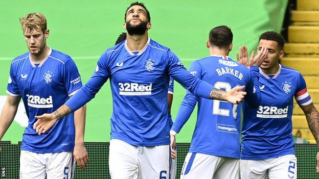Connor Goldson (centre) celebrates one of his Rangers goals