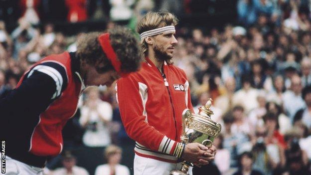 Bjorn Borg holds the Wimbledon trophy after beating John McEnroe in the 1980 final