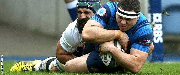 Guilhem Guirado plunges over to score the first try for France