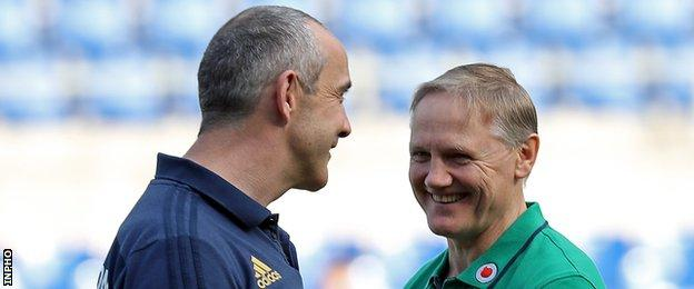Joe Schmidt talks to Italy coach Conor O'Shea before the match in Rome