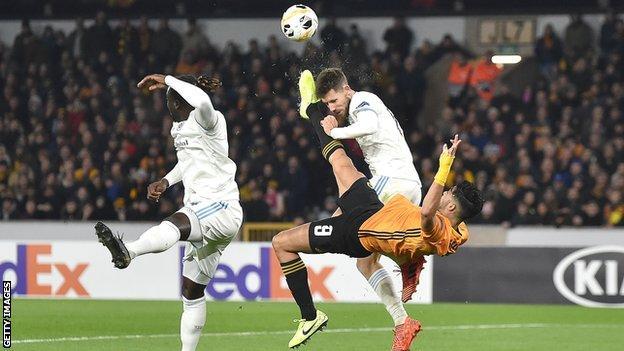 Kenan Bajric is kicked in the head by Raul Jimenez