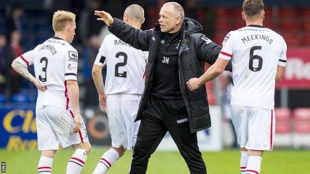 John Hughes congratulates his victorious players