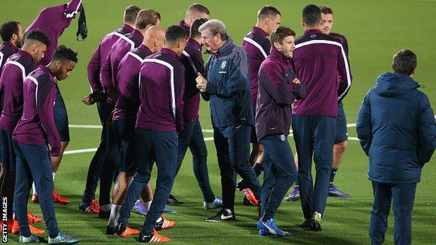 England boss Roy Hodgson with his players