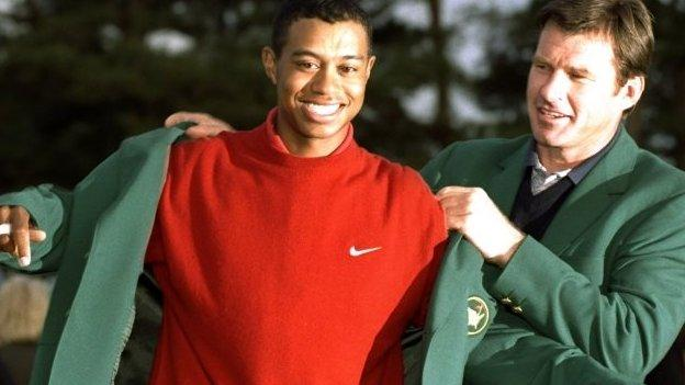 Nick Faldo presenting 1997 Masters champion Tiger Woods with his first Green Jacket