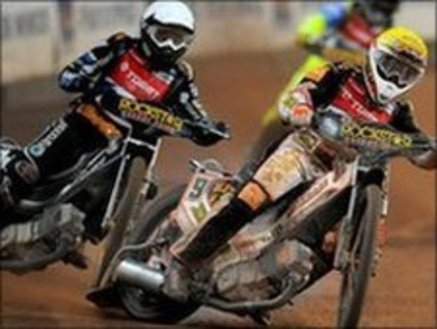 Speedway riders in action