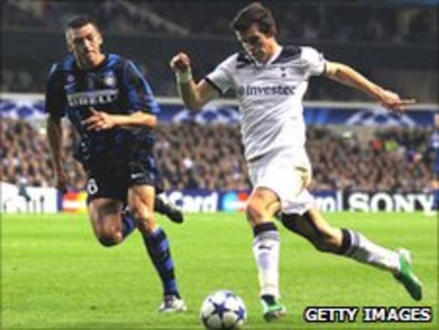 Gareth Bale of Spurs takes on Lucio of Inter Milan