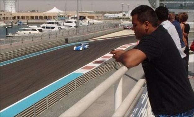 Samit Patel watches the race cars in Abu Dhabi