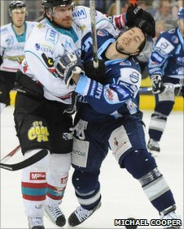 Belfast's Brandon Benedict and Brian Lee battle for possession
