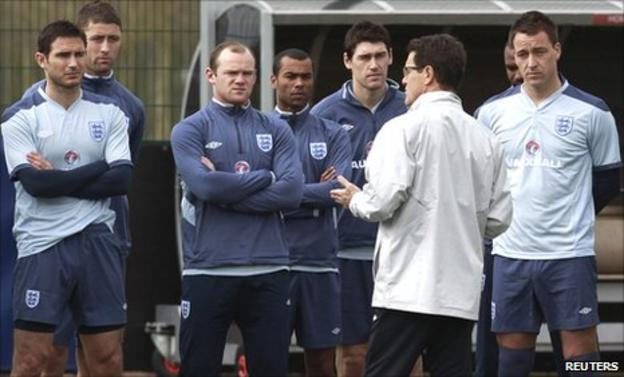 England coach Fabio Capello (second right) talks to (from left to right) Frank Lampard, Gary Cahill, Wayne Rooney, Ashley Cole, Gareth Barry and John Terry