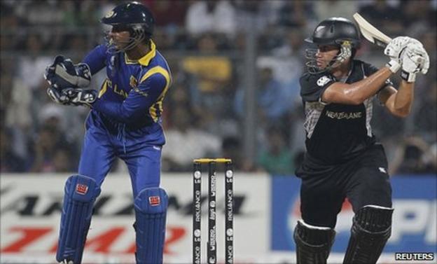 New Zealand's Ross Taylor plays a shot next to Sri Lanka's captain and wicketkeeper Kumar Sangakkara