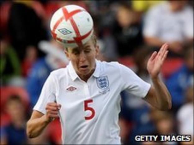 England captain Faye White heads the ball