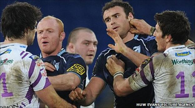 Jamie Roberts, James Hook, Martyn Williams and Mike Phillips tussle in December 2010