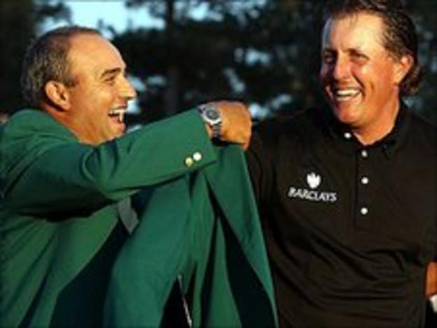 Mickelson receives his third green jacket from Angel Cabrera last year