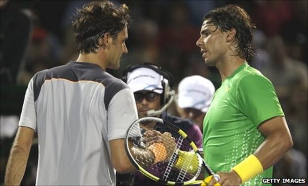 Roger Federer (left) shakes hands with Rafael Nadal after his defeat in Miami