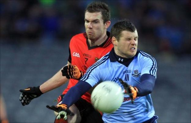 Down's Declan Rooney and Dublin's Kevin McManamon