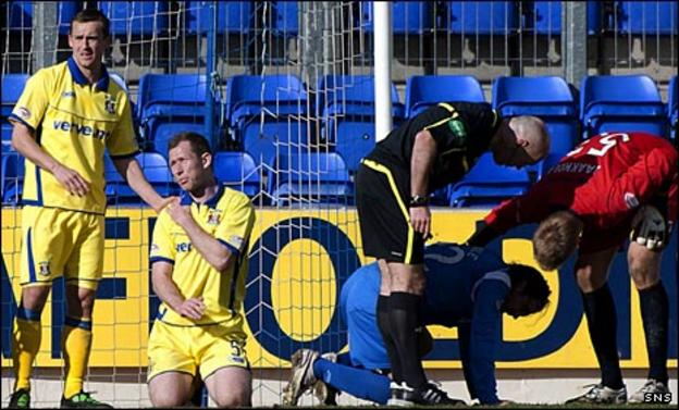 Frazer Wright and Danny Invincibile lie injured at McDiarmid Park