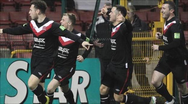 Mark Quigley leads the celebrations after his equaliser at Solitude