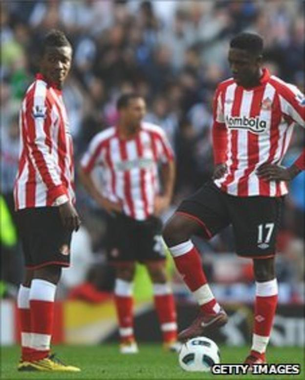 Asamoah Gyan and Danny Welbeck prepare for the restart