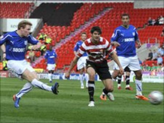 Chris Burke scores Cardiff's opener at Doncaster