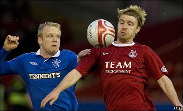 Rangers' Steven Naismith challenges Aberdeen's Steven Smith