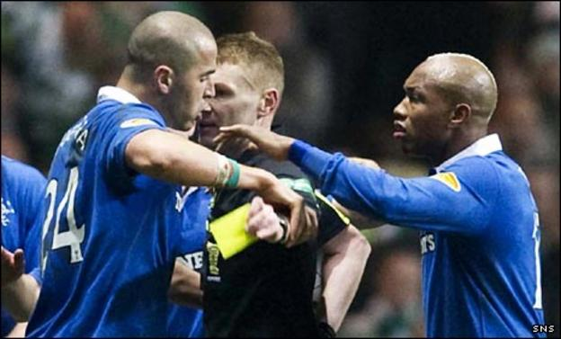 Madjid Bougherra (left) attempts to prevent referee Calum Murray issuing a yellow card