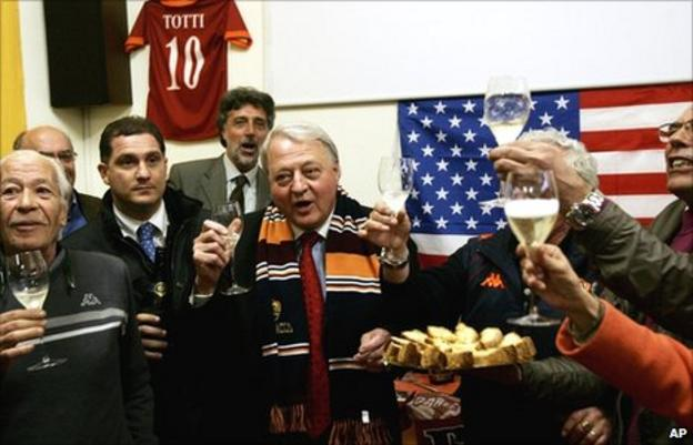 Thomas DiBenedetto (centre) toasts his Roma takeover deal on 31 March