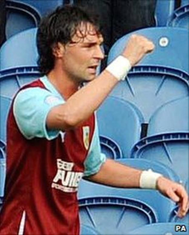 Chris Eagles celebrates after his penalty gives Burnley victory