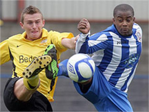 Glenavon's Jay Magee in action against Leon Knight of Coleraine