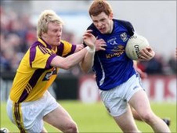 Sean Gaule tackles Cavan's Niall McDermott in the semi-final