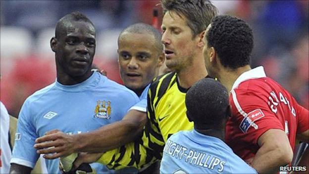 Man Utd defender Rio Ferdinand (right) confronted Man City striker Mario Balotelli at the final whistle