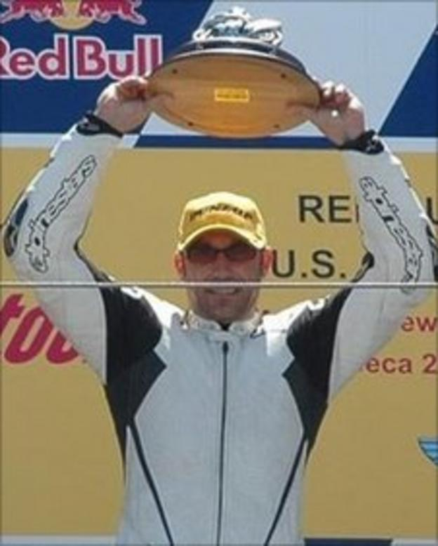 Jeremy Toye celebrates a motocross victory at Laguna Seca in the US