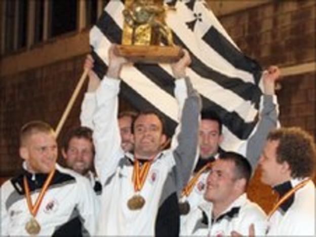 Matthieu le Dour holding the European Trophy aloft